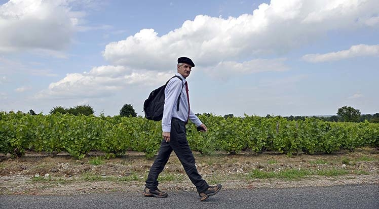"French MoDem party member of parliament Jean Lassalle walks on August 9, 2013 on a road near Corcelles-en-Beaujolais, southeasthern France, as part of his protest march. Lassalle walks on French roads since April 10, 2013, to ""hear the suffering, doubt, but also the aspirations and hopes of French people.""   AFP PHOTO/PHILIPPE DESMAZES / AFP PHOTO / PHILIPPE DESMAZES"